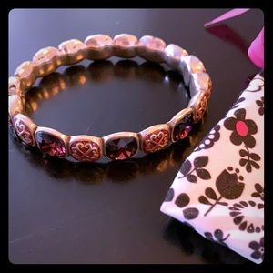 Clasp bracelet with purple stones.